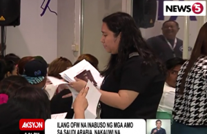 Repatriated OFWs being processed at airport